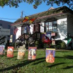 The Backyard Naturalist is the house on the corner with all the flags, wind spinners and whirligigs.