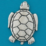 Small coin or token handcrafted in lead free pewter is engraved, shaped like a turtle with inspiration message on back.