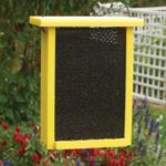 The Backyard Naturalist carries the Going Green Recycled Finch Mesh Feeder in Yellow, for nyjer thistle seed
