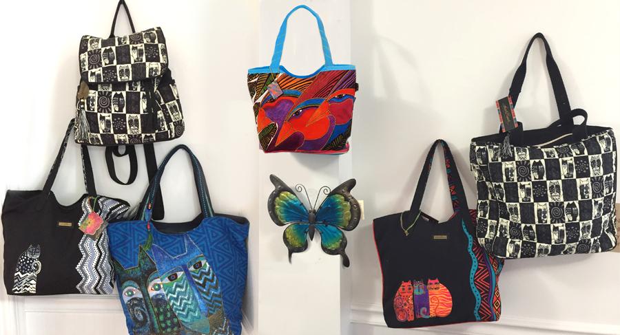 The Backyard Naturalist Annex display of Laurel Burch tote bags.