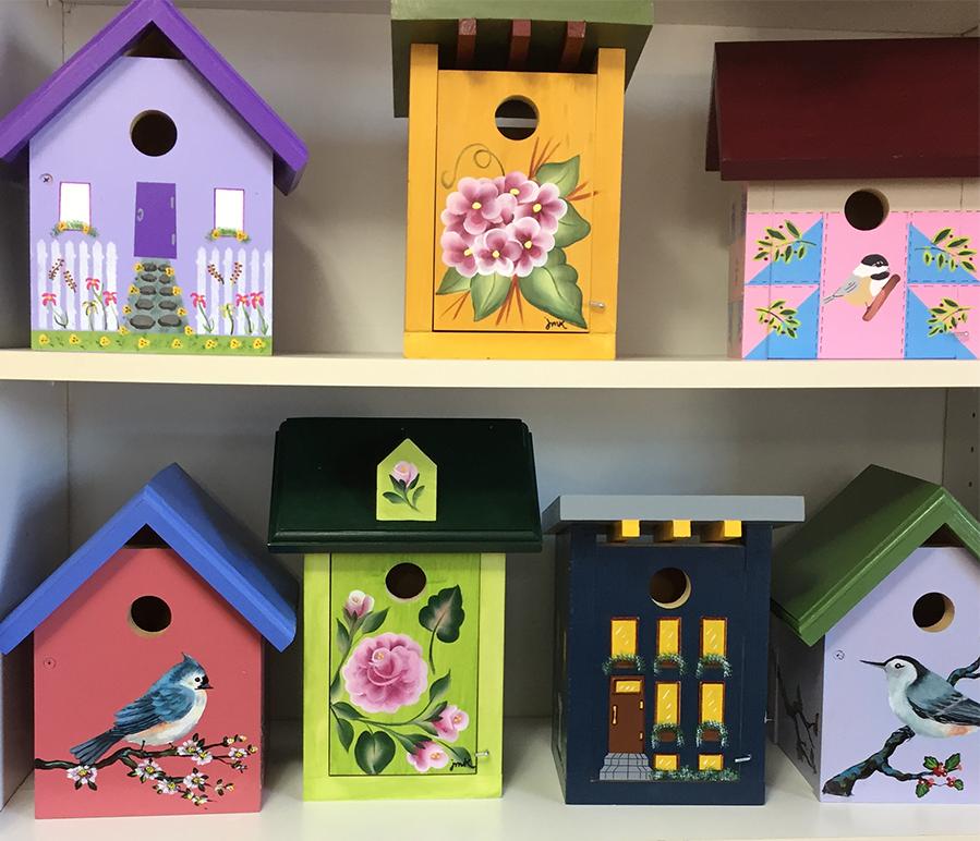 The Backyard Naturalist Annex Hand Painted Bird House display.