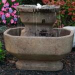 The Backyard Naturalist has concrete bird baths by Massarelli, like 'Two Tier San Marin'.