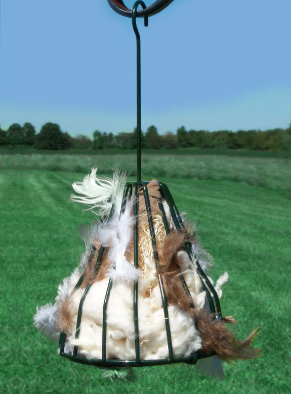 The Backyard Naturalist's Birdie Bell with Nesting Materials, all-natural, including: Feathers, String, Cotton, Hemp, and Aspen fiber. Comes ready to hang and doubles as a seed bell holder when nesting season is over.