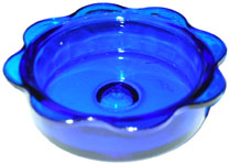 The Backyard Naturalist has the beautifully simple step-in Bluebird feeder with a blue glass dish, as in this detail image.