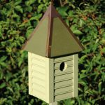 The Backyard Naturalist stocks biologically species correct bird houses in a variety of styles, like the stylish, copper-roofed Gatehouse in Celery Green. Other colors available.