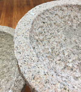 The Backyard Naturalist has granite bird baths in two sizes. Natural texture (close up) and colors and weatherproof for winter.