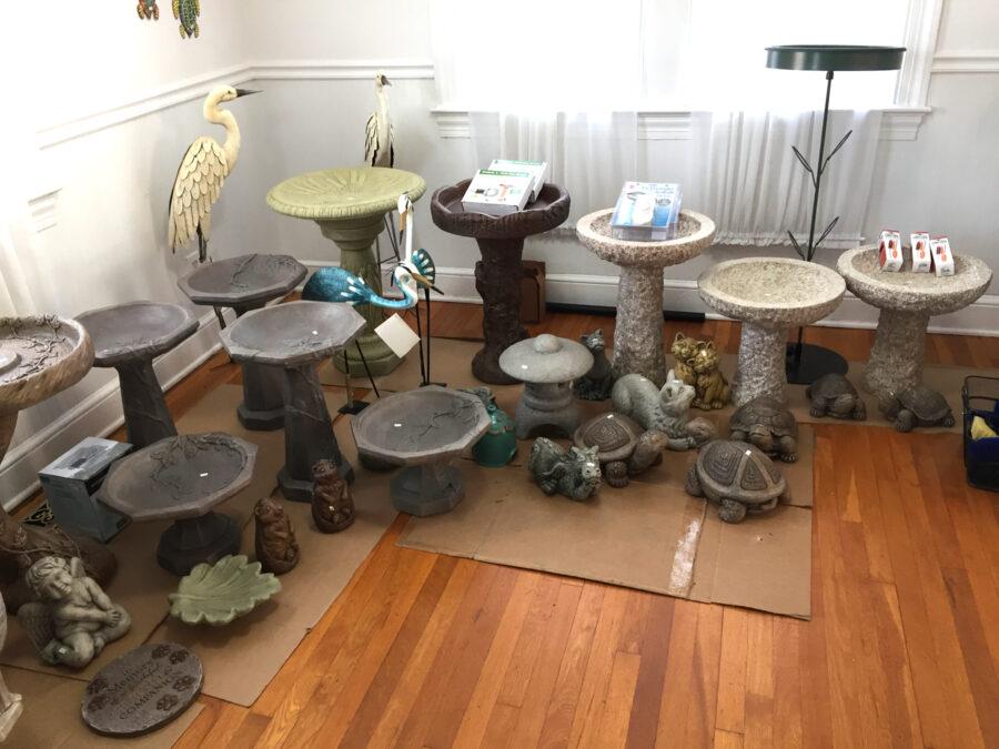 The Backyard Naturalist's Holiday Annex 2020 display of bird baths and garden statuary.
