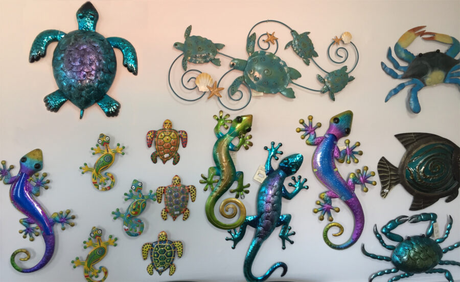 The Backyard Naturalist's Holiday Annex 2020 has a display of metal wall art with sea creatures, frogs, lizards, fish, crabs, turtles and chameleons.