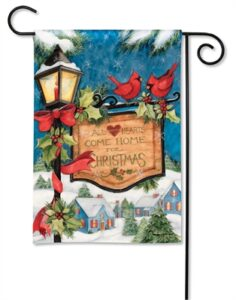 The Backyard Naturalist Holiday Flag Selection for 2020 includes 'All Hearts Come Home for Christmas' sign on old fashioned lamppost and cardinals village scene