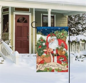 The Backyard Naturalist Holiday Flag Selection for 2020 includes 'Christmas Magic' yard flags pictured here in a snowy suburban front yard