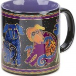 "The Backyard Naturalist has Laurel Burch illustrated mug ""Dog & Doggies"" in stock now."
