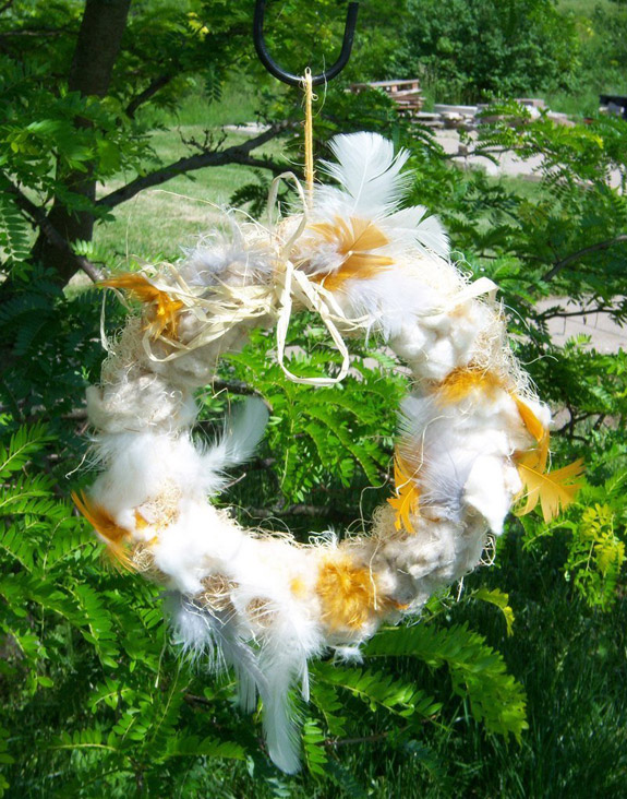 Hang an all-natural wild bird nesting material wreath from The Backyard Naturalist.