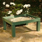 The Backyard Naturalist has feeders made from recycled materials, like this Platform Ground Feeder with Legs, in Hunter Green.